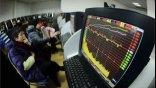 Προβληματισμό προκαλεί στις διεθνείς αγορές η υποτίμηση του κινεζικού νομίσματος