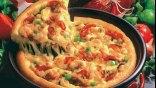 Για Γκίνες η συλλογή του από ... πίτσες!